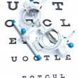 Optometry concept - sight measuring spectacles & eye chart — Foto Stock #7422911