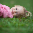 Cute little girl outdoors in a park — Stock Photo #7423110