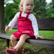 Cute little girl outdoors in a park — Stock Photo