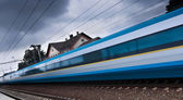 Fast train passing by (motion blur is used to convey movement) — Stock Photo