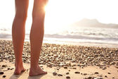 Beautiful young woman on the beach - legs — Stock Photo