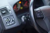 Modern car interior - detail of the steering wheel — Stock Photo