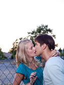 Young lovely couple kissing lovingly — Stock Photo