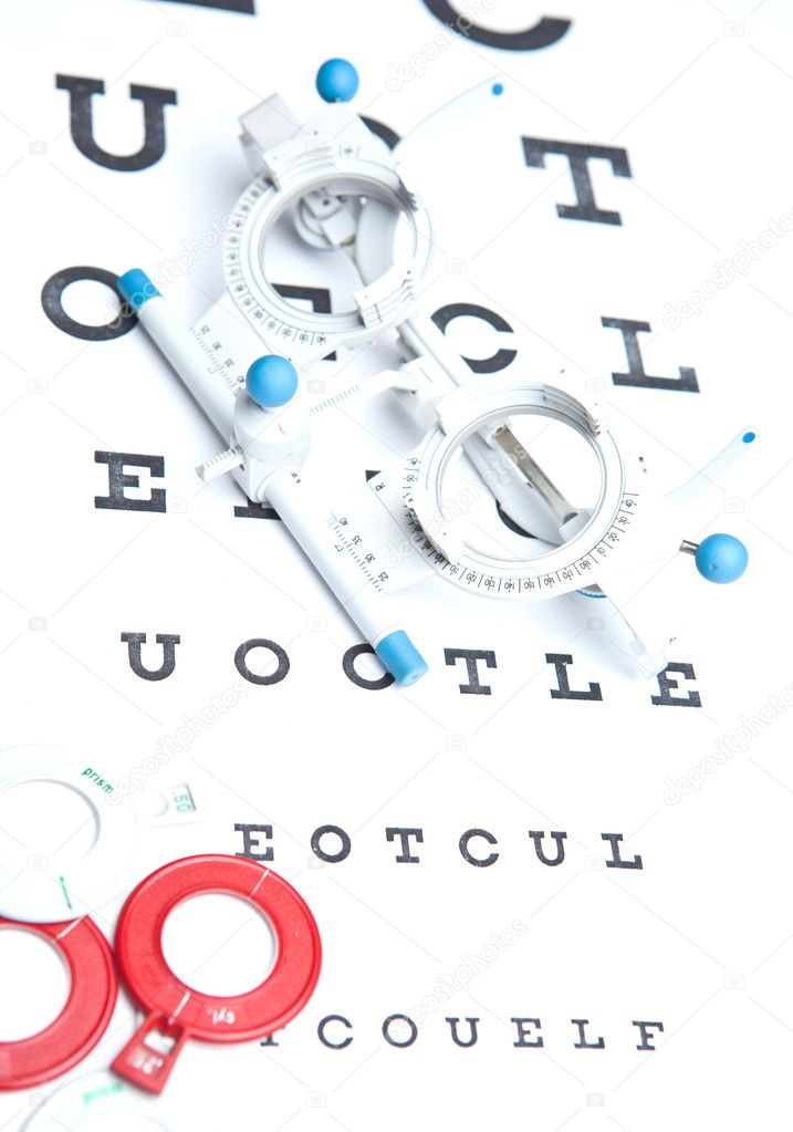 Optometry concept - sight measuring spectacles & eye chart  Stock Photo #7422906