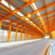 Orange tunnel and highway at day — Stock Photo