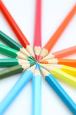 Color pencils in arrange in color wheel colors on white backgrou — Stock Photo