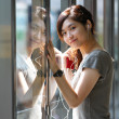 Asian woman listening music in station — Stock Photo