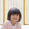 A young asian girl smiling — Stock Photo