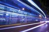 Light trails at night with busy traffic — Stock Photo