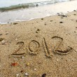 2012 year written on the beach sand — Stock Photo