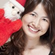 Christmas celebration by asian woman — Stock Photo