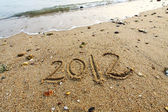 2012 year written on the beach sand — 图库照片