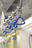 Handles for standing passenger inside a train — Stock Photo