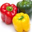 Bell peppers (green, yellow and red) isolated on white backgroun - Stock Photo