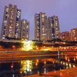 Hong Kong apartment blocks at sunset time - Stock Photo