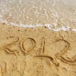 Stock Photo: 2012 handwriting on sand