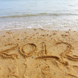 Royalty-Free Stock Photo: 2012 handwriting on sand