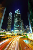 Traffic in city at night, it shows the busy business environment — Photo
