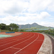 Sports stadium with running track at day — Stock Photo