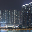 Hong Kong apartment blocks at night, showing the packed conditio — Stock Photo