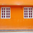 Vintage wall and windows in orange background — Stock Photo