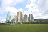Hong Kong downtown with residential buildings and sports court — Stock Photo