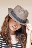 Asian stylish woman wearing hat — Stock Photo