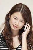 Asian woman using phone — Stock Photo