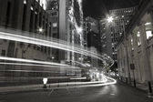 Traffic in city at night in black and white toned — Stock Photo