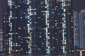 Hong Kong apartment blocks at night — Stock Photo