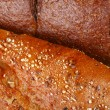 Five grain Italian and pumpernickel breads macro — Stock Photo