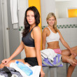 Locker room two sportive women sitting fitness — Stock Photo