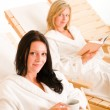 Beauty spa relax two women on sun-beds — Stock Photo #6812700