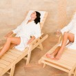 Beauty spa room two women relax sun-beds — Stock Photo #6812706