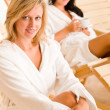 Luxury spa two women relax sitting sun-beds — Stock Photo #6812710