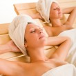 Beauty spa room two women relax sun-beds — Stock Photo #6812729