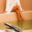 Relax spa pool flip-flops woman wear bathrobe — Stock Photo #6812737