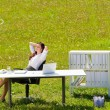 Businesswoman in sunny meadow relax nature office — Stock Photo