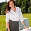 Businesswoman outside nature blue sky office smile — Stock Photo