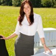Businesswoman in sunny nature office smile - Stock Photo