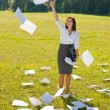 Businesswoman sunny meadow throw papers freedom — Stock Photo