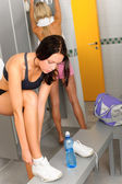 Locker room two sportive women getting ready — Stock Photo
