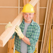 Handyman carpenter mature carry wooden beam — Stock Photo #6879345