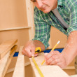 Handyman home improvement close-up of measure wood — Stock Photo