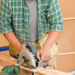 Handyman home improvement cut wood with jigsaw — Stock Photo