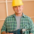 Handyman home improvement with hand drill — Stock Photo #6879389