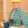 Handyman home improvement working with jackhammer — Stock Photo