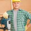 Handyman home improvement working with jackhammer — Stock Photo #6879401