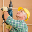Handyman home improvement working with jackhammer — Stock Photo #6879403