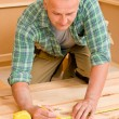 Handyman home improvement wooden floor renovation — Stock Photo